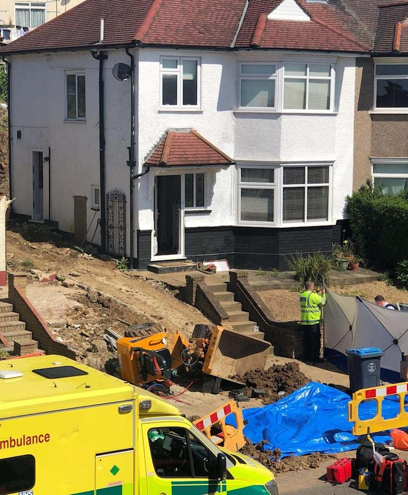 It is understood that the small dumper vehicle tipped down a slope while the woman was carrying out the work