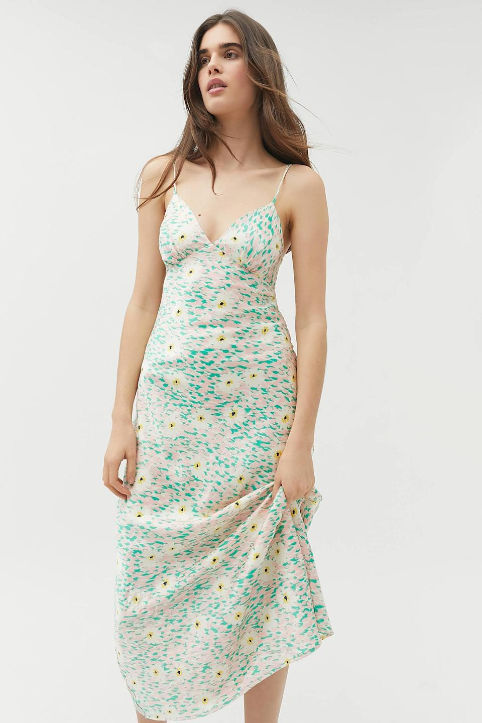 "<p>This <a href=""https://www.popsugar.com/buy/UO-Picnic-Two-Floral-Midi-Slip-Dress-544758?p_name=UO%20Picnic%20For%20Two%20Floral%20Midi%20Slip%20Dress&retailer=urbanoutfitters.com&pid=544758&price=79&evar1=fab%3Aus&evar9=45873724&evar98=https%3A%2F%2Fwww.popsugar.com%2Ffashion%2Fphoto-gallery%2F45873724%2Fimage%2F47261785%2FUO-Picnic-For-Two-Floral-Midi-Slip-Dress&list1=shopping%2Cdresses%2Cspring%2Cflorals%2Cspring%20fashion&prop13=mobile&pdata=1"" class=""link rapid-noclick-resp"" rel=""nofollow noopener"" target=""_blank"" data-ylk=""slk:UO Picnic For Two Floral Midi Slip Dress"">UO Picnic For Two Floral Midi Slip Dress</a> ($79) is so lovely.</p>"