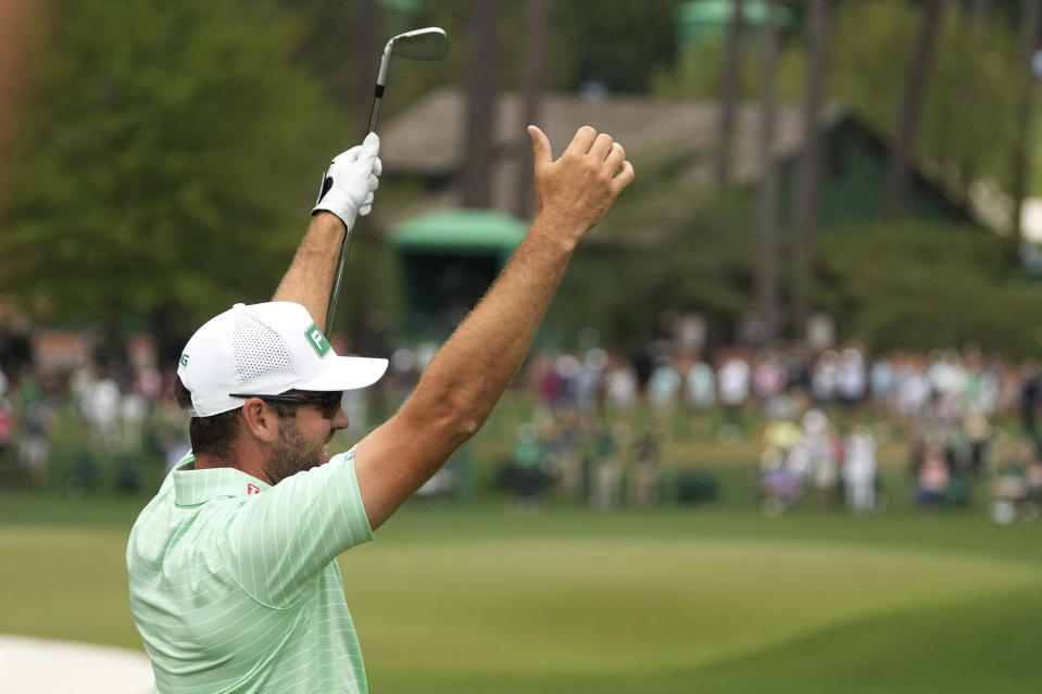 Corey Conners, of Canada, celebrates after a hole-in-one on the sixth hole during the third round of the Masters golf tournament on Saturday, April 10, 2021, in Augusta, Ga. (AP Photo/Charlie Riedel)