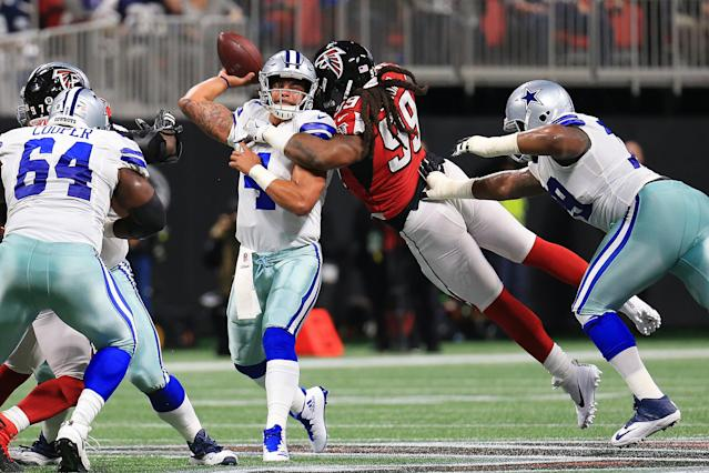 <p>Dak Prescott #4 of the Dallas Cowboys is hit by Adrian Clayborn #99 of the Atlanta Falcons while throwing during the first half at Mercedes-Benz Stadium on November 12, 2017 in Atlanta, Georgia. (Photo by Daniel Shirey/Getty Images) </p>