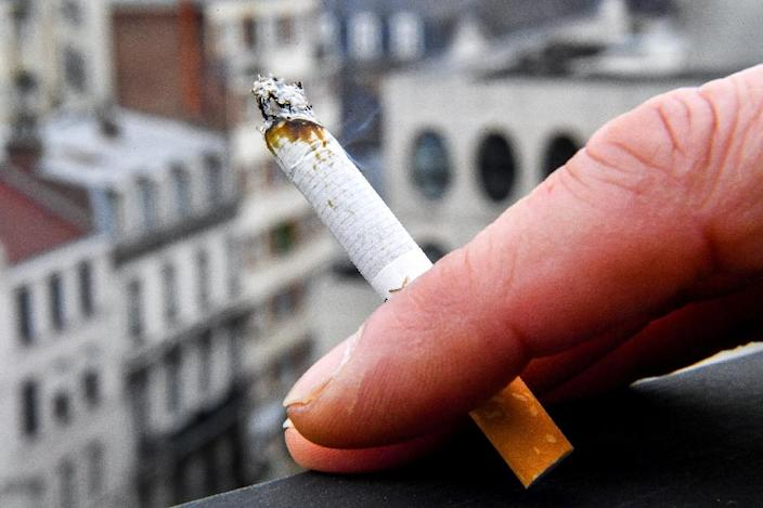 Some 34 million US adults smoke cigarettes, according to a 2017 survey, but this 14 percent smoker rate is down from 15.5 percent in 2016 (AFP Photo/PHILIPPE HUGUEN)