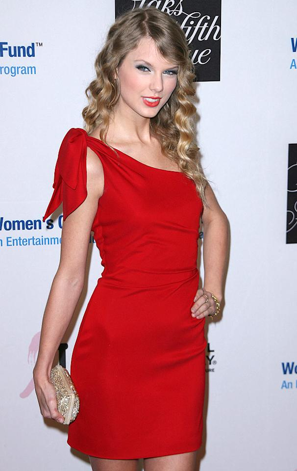 """Singer, actress ... greeting card entrepreneur? Taylor Swift, looking chic in red at the EIF's Women's Cancer Research Fund benefit, announced her plan to launch a card line with American Greetings. Perhaps she can send a personally designed condolence card to America Ferrera? Andy Fossum/<a href=""""http://www.splashnewsonline.com"""" target=""""new"""">Splash News</a> - January 27, 2010"""