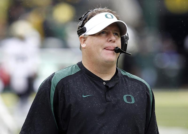 FILE - In this Oct. 27, 2012, file photo, Oregon football coach Chip Kelly watches the clock wind down during the final moments of an NCAA college football game against Colorado in Eugene, Ore. The NCAA has taken away a scholarship and placed Oregon's football program on probation for three years for recruiting violations under previous coach Kelly. (AP Photo/Don Ryan, file)