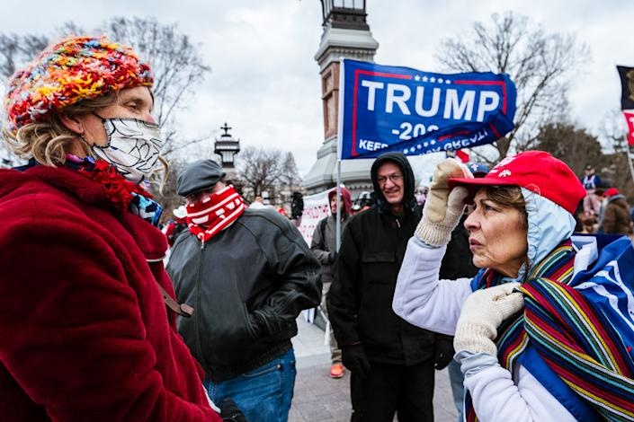 A pair of counterprotesters are confronted by pro-Trump protesters in front of Capitol on Jan. 6.