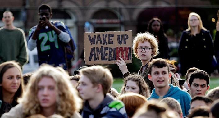 <p>Students look on during a walkout from classes to protest the election of Donald Trump as president, Monday, Nov. 14, 2016, in Seattle. (AP Photo/Elaine Thompson) </p>