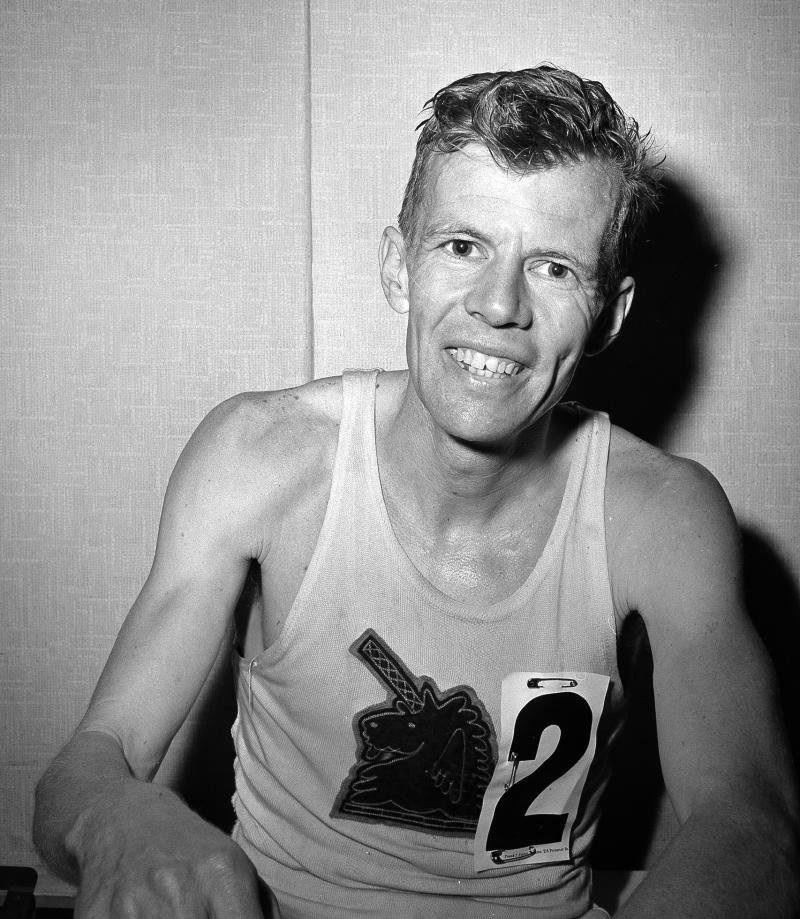FILE - In this April 1962 file photo, John J. Kelley sits in his dressing room after finishing fourth in the Boston Marathon in Boston. Kelley, winner of the 1957 Boston Marathon and known to his fans as the first modern American road runner, has died. Amby Burfoot, a friend whom Kelley coached in high school in Groton in the early 1960s, confirmed his death. He said Kelley died Sunday, Aug. 21, 2011, in Stonington, Conn., at his daughter's home from a melanoma that spread to his lungs. He was 80. (AP Photo/File)