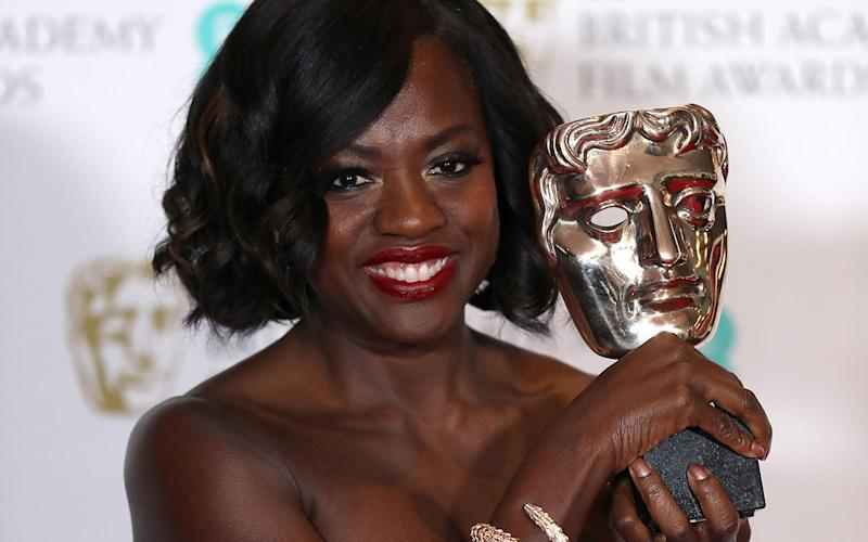 Suppoting Actress winner Viola Davis poses with her award in the winners room during the 70th EE British Academy Film Awards (BAFTA) at Royal Albert Hall on February 12, 2017 in London, England. (Photo by Chris Jackson/Getty Images)