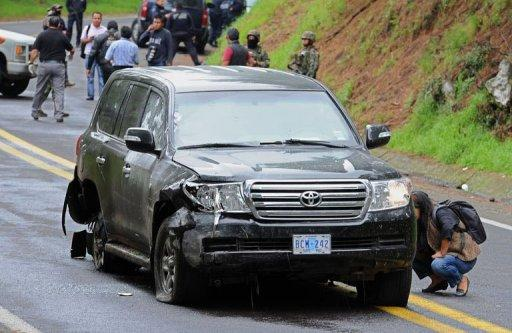 Forensic personnel check a US diplomatic vehicle attacked with gunfire in the Tres Marias-Huitzilac highway in Morelos, Mexico. The Mexican government said federal police shot at the vehicle as they were chasing criminals