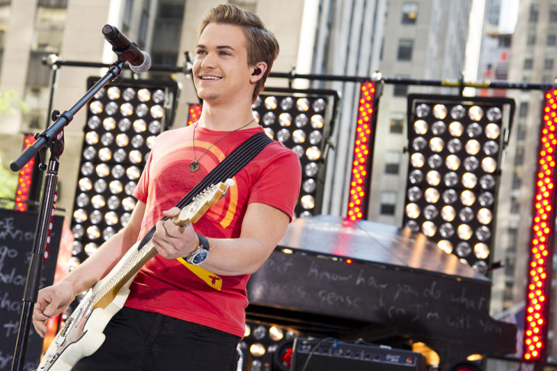 """FILE - In this June 21, 2013 file photo, Hunter Hayes performs on NBC's """"Today"""" show in New York. Philadelphia's Office of City Representatives says Lovato has canceled her appearance at Thursday's Fourth of July concert because of strep throat. She's being replaced by 22-year-old country singer Hunter Hays. (Photo by Charles Sykes/Invision/AP, File)"""