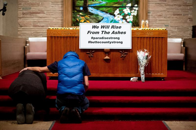 More than 50 people gathered at a memorial for the victims of the deadly blaze. (Pool via Getty Images)