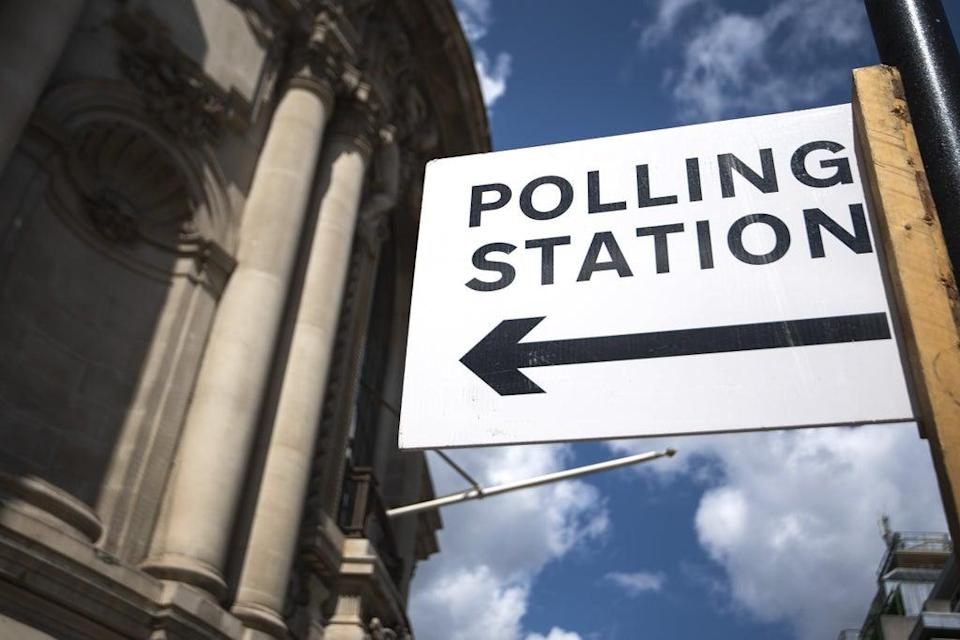 Signage outside a polling station in central Westminster (PA) (PA Wire)