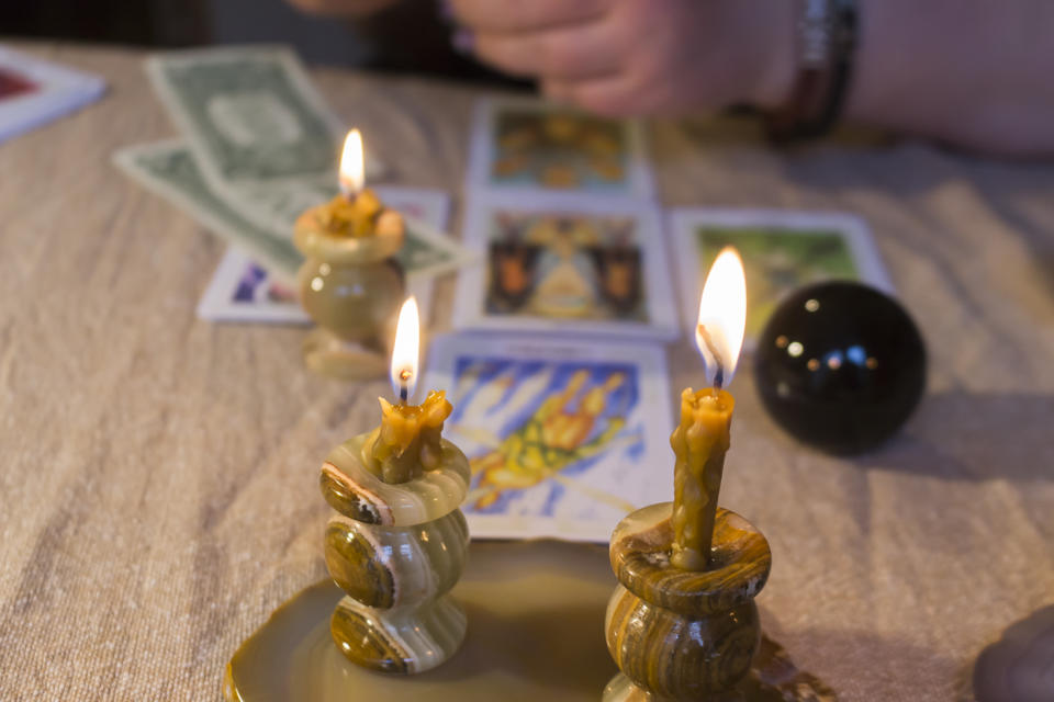 Russia, Moscow, June 11, 2021. Tarot cards on a wooden table. Magical rituals. Illustrative editorial.
