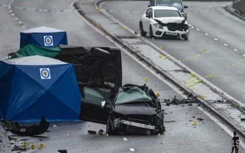 Police officers work at the scene of a multi-vehicle crash on Lee Bank Middleway, Edgbaston - Credit: Christopher Furlong/Getty Images