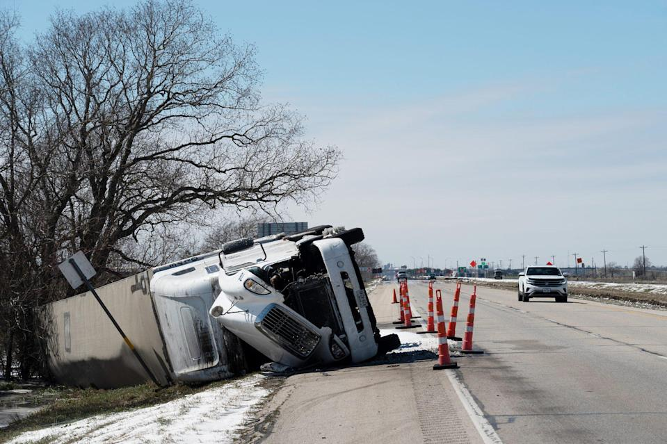 <p>A large trailer truck flipped sideways on Highway 59 in Pierce, Texas, after the winter storm left roads in dangerous condition. </p>