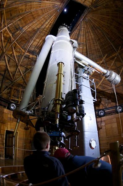The moon shines above the Clark Telescope at the Lowell Observatory, Flagstaff, Arizona. File photo undated.