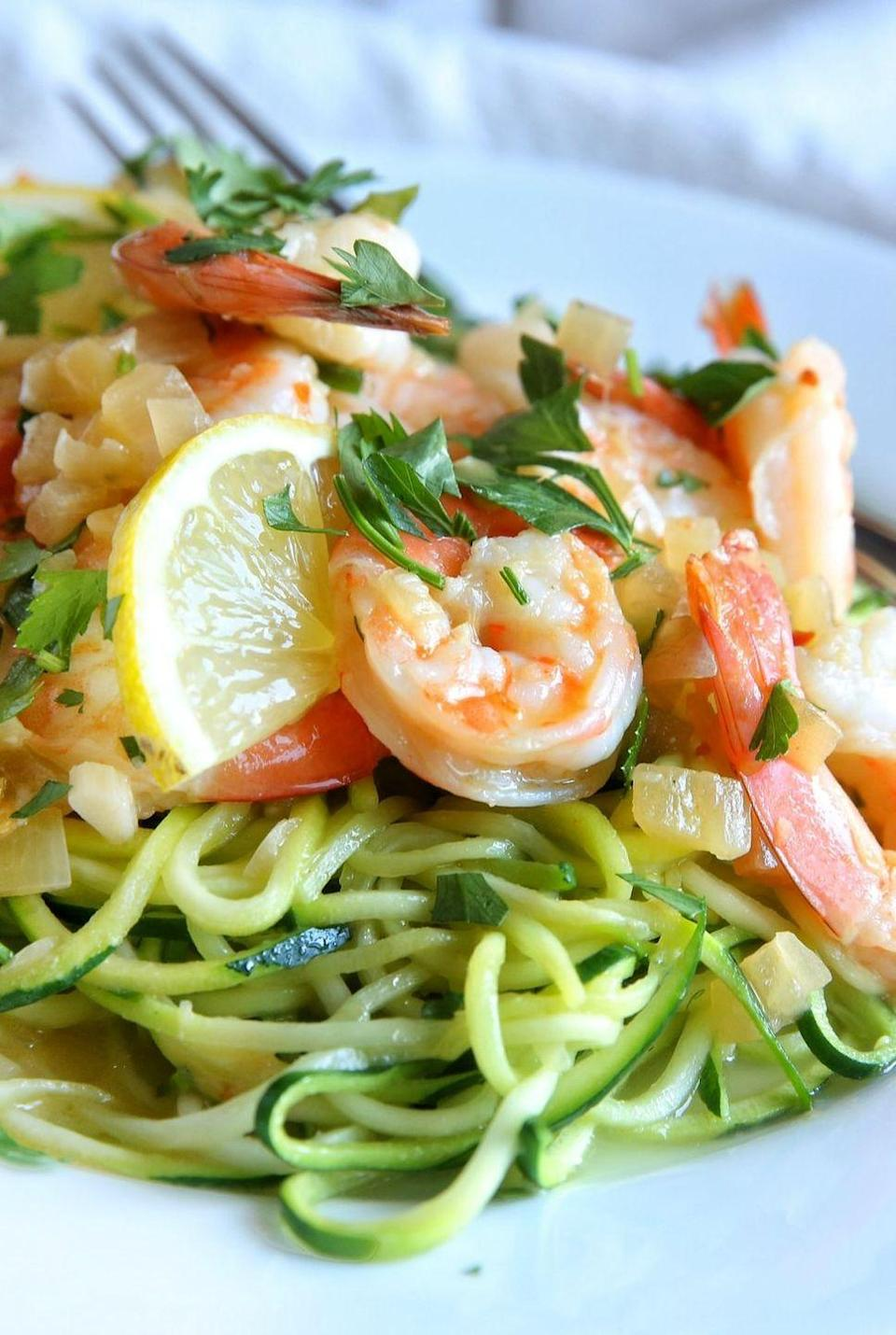 """<p>This healthy spin on shrimp scampi swaps zucchini noodles for pasta.<br><br>Get the recipe from <a href=""""https://www.delish.com/cooking/recipe-ideas/recipes/a47388/shrimp-scampi-zoodles-recipe/"""" rel=""""nofollow noopener"""" target=""""_blank"""" data-ylk=""""slk:Delish"""" class=""""link rapid-noclick-resp"""">Delish</a>.</p>"""