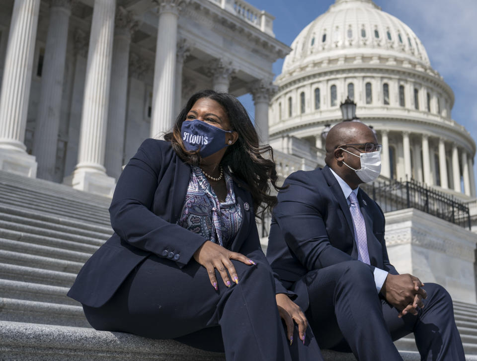 Rep. Cori Bush, D-Mo., left, and Rep. Jamaal Bowman, D-N.Y., enjoy the warm weather before a vote in the House, at the Capitol in Washington, Thursday, March 11, 2021. (AP Photo/J. Scott Applewhite)