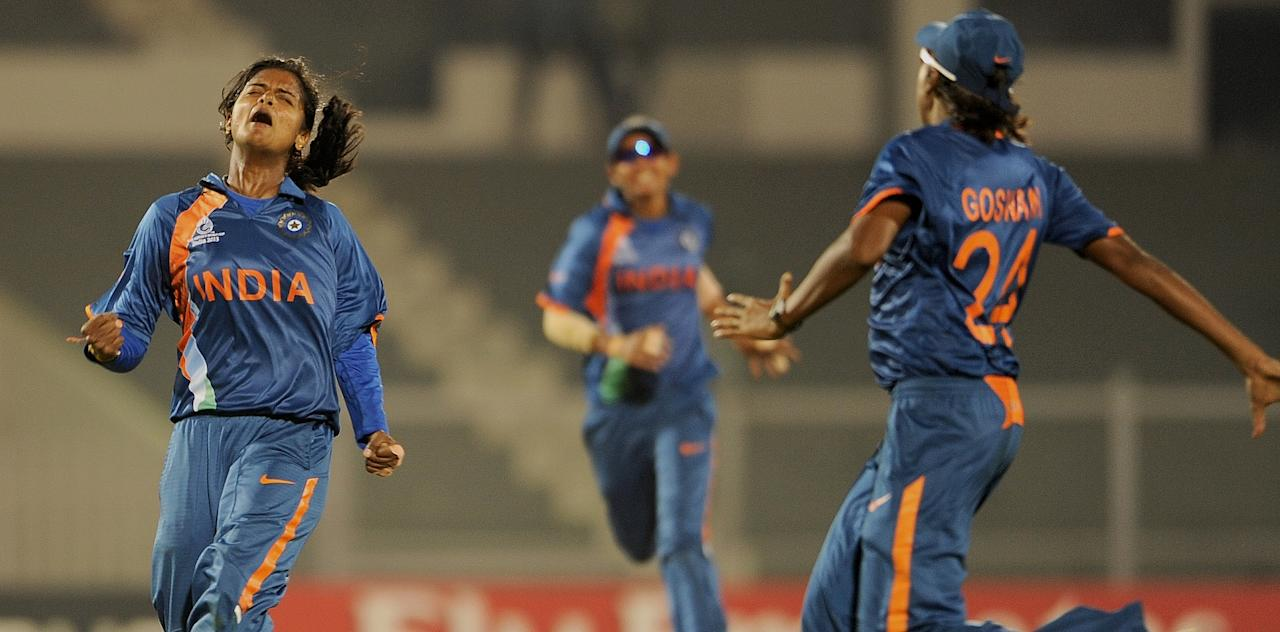 Indian cricketer Niranjana Nagarajan (L) celebrates after taking the wicket of West Indian cricketer Deandra Dottin during the inaugural match of the ICC Women's World Cup 2013 between India and West Indies at the Cricket Club of India's Brabourne stadium in Mumbai on January 31, 2013.   AFP PHOTO/Indranil MUKHERJEE        (Photo credit should read INDRANIL MUKHERJEE/AFP/Getty Images)