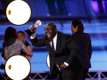 Steve McQueen holds up the award for best picture at the 19th annual Critics' Choice Movie Awards in Santa Monica