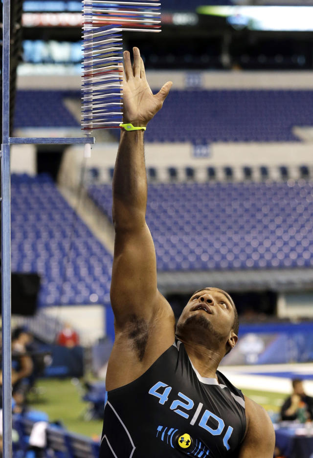 Missouri defensive lineman Michael Sam reaches during a vertical jump test at the NFL football scouting combine in Indianapolis, Monday, Feb. 24, 2014. (AP Photo/Nam Y. Huh)