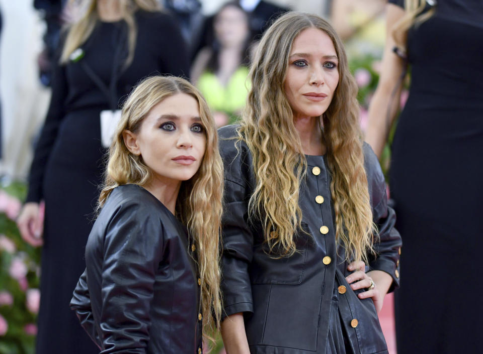 "Mary Kate Olsen, left, and Ashley Olsen attend The Metropolitan Museum of Art's Costume Institute benefit gala celebrating the opening of the ""Camp: Notes on Fashion"" exhibition on Monday, May 6, 2019, in New York. (Photo by Charles Sykes/Invision/AP)"