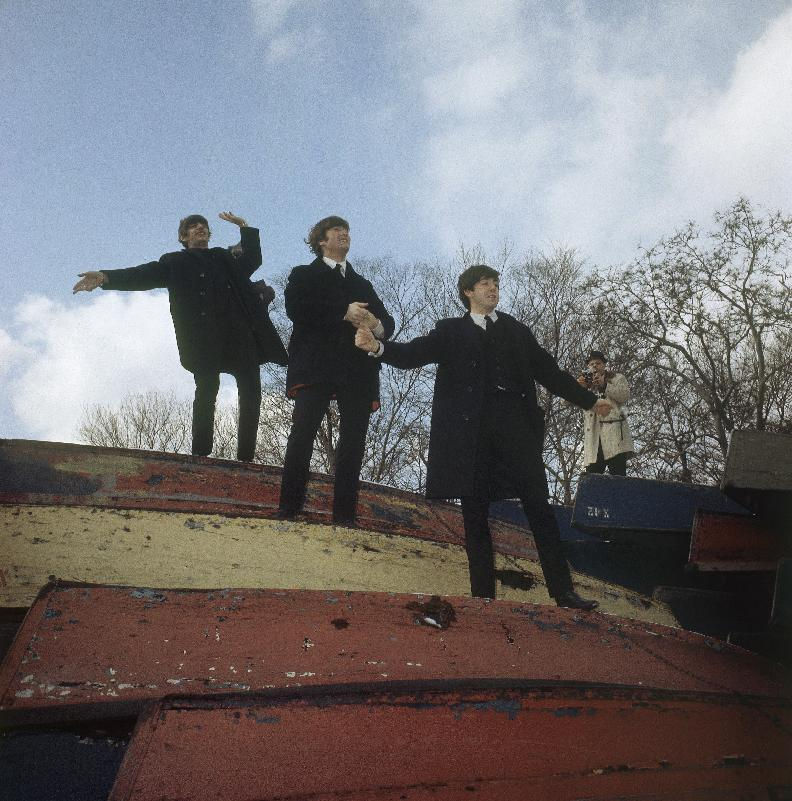 FILE - In this Feb. 10, 1964, file photo, three members of the Beatles pose on a stack of rowboats in New York's Central Park. From the top are: Ringo Starr, John Lennon and Paul McCartney. McCartney turned 70 Monday June 18, 2012. (AP Photo)