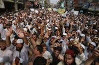 Supporters of a religious group chant slogans during a rally favoring the Khalid Khan, who gunned down Tahir Naseem in courtroom, in Peshawar, Pakistan, Friday, July 31, 2020. Naseem, a U.S. citizen, according to a U.S. State Department statement, was gunned down this week in a Pakistani courtroom while standing trial on a charge of blasphemy. (AP Photo/Muhammad Sajjad)