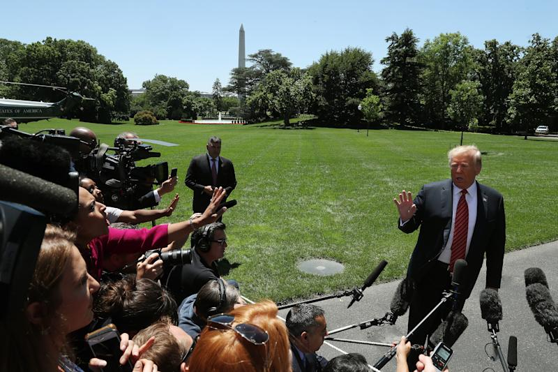 President Donald Trump speaks to reporters before departing for Iowa on June 11, 2019.