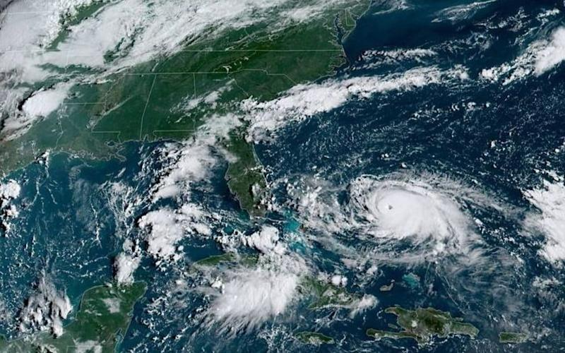 This satellite image shows Tropical Storm Dorian as it approaches the Bahamas and Florida