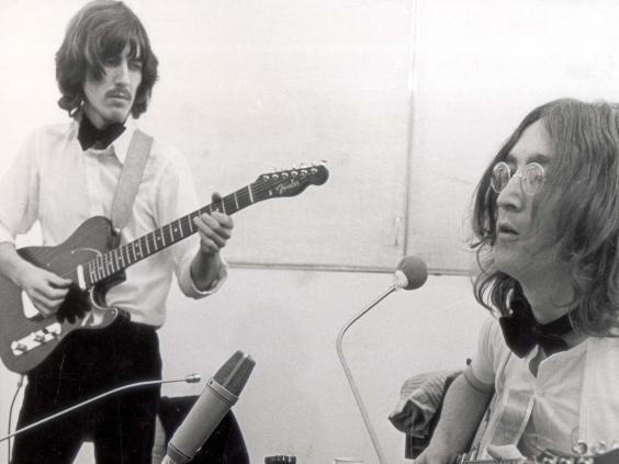 George Harrison and John Lennon in a London studio recording 'Let It Be' (Daily Sketch/Shutterstock)