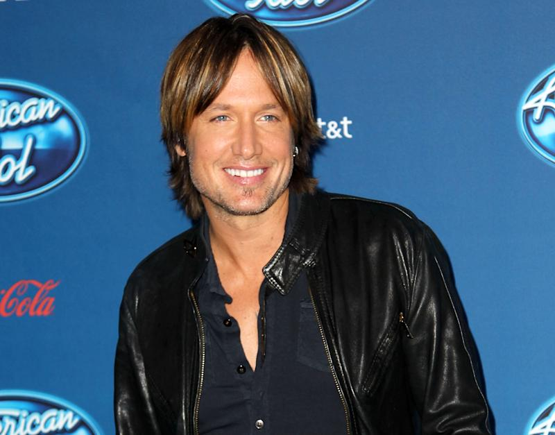 "FILE - This Jan. 9, 2013 file photo shows Keith Urban at the ""American Idol"" premiere event at Royce Hall on the campus of UCLA in Los Angeles. Urban is a judge on the singing competition series airing Wednesdays and Thursdays on Fox. (Photo by Matt Sayles/Invision/AP, file)"
