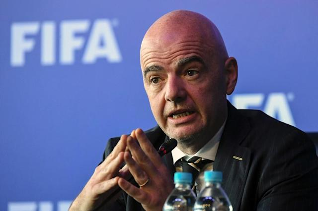 "FIFA President Gianni Infantino said that Russia is ""very committed to this World Cup being a total success"" (AFP Photo/Luis ACOSTA)"