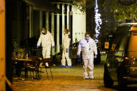 Three persons investigate at the scene following gunfire on people enjoying a last evening out before lockdown in the Austrian capital Vienna, Tuesday, Nov. 3, 2020. Police in the Austrian capital said several shots were fired shortly after 8 p.m. local time on Monday, Nov. 2, in a lively street in the city center of Vienna. Austria's top security official said authorities believe there were several gunmen involved and that a police operation was still ongoing. (Photo/Ronald Zak)