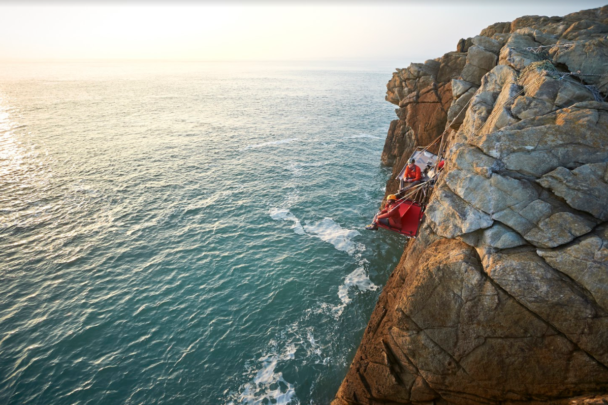 <p>Those with a head for heights, look no further than cliff camping. You sleep on a small portaledge on a sheer rock face, suspended up to 200ft in the air with the crashing sea below. Thankfully you're attached to your bed – and you'll find the nights are wonderfully alive if you're unable to nod off. Gaia Adventures offers cliff camping in North Wales, from £450. [Photo: Gaia Adventures] </p>