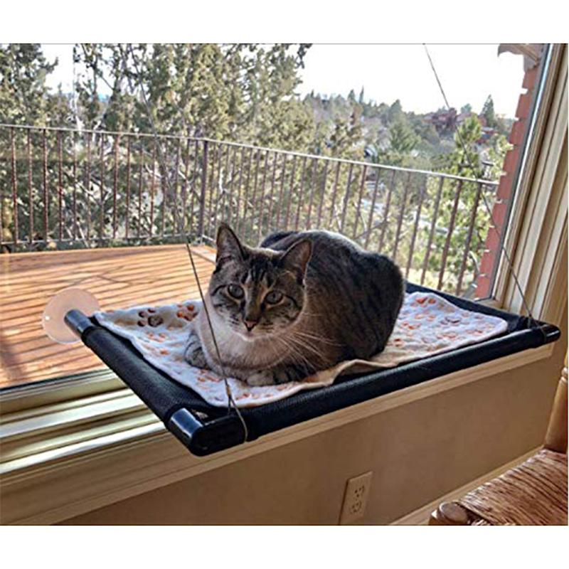Cat Hammock Window Bed Perch Seat Sunny for Lager Cats Perches Furniture Two Kitty Window Sill Seat Window Mounted Animal Pet Kitten Cot Beds Gre1Bee Upgraded Version 4 Big Suction Cups Holds Up 50lb (Cat bed window). Image via Amazon.