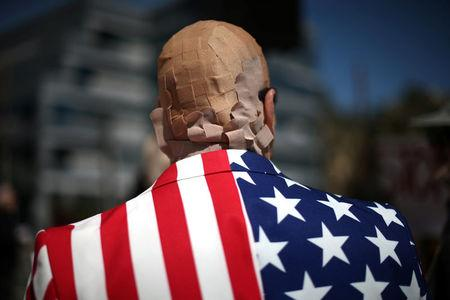 Mike Stutz is seen with his head covered in band aids to protest against President Trump's proposed replacement for Obamacare in Los Angeles, California, U.S., March 14, 2017. REUTERS/Lucy Nicholson