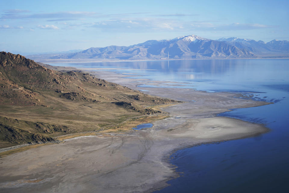 FILE - The Great Salt Lake recedes from Anthelope Island on May 4, 2021, near Salt Lake City. The water levels at the Great Salt Lake have hit a historic low, a grim milestone for the largest natural lake west of the Mississippi River that comes as a megadrought grips the region. (AP Photo/Rick Bowmer, File)