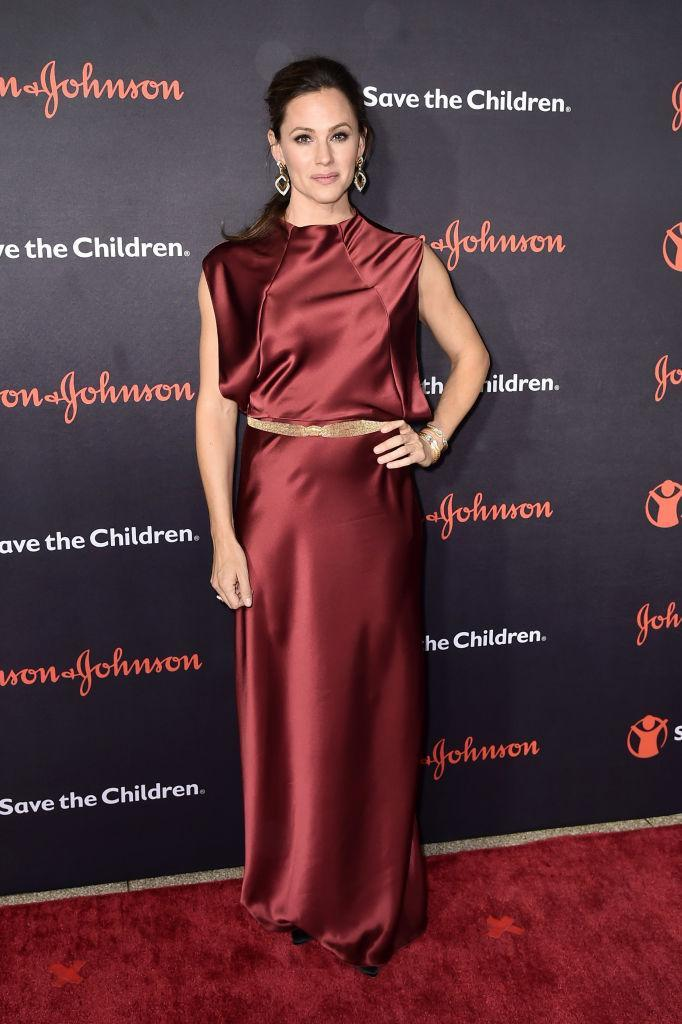 <p>On November 14, Jennifer Garner attended the annual Save the Children Illumination Gala at the American Museum of Natural History. For the event, she wore a maroon-hued dress complete with a gold belt and co-ordinating earrings. <em>[Photo: Getty]</em> </p>