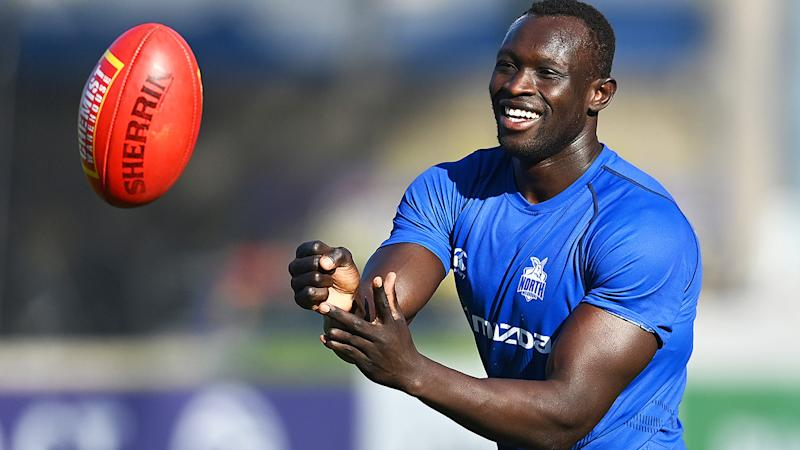 Majak Daw is pictured handballing during a North Melbourne training session.