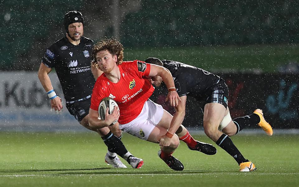 Ben Healy of Munster is tackled by Robbie Fergusson of Glasgow Warriors - GETTY IMAGES