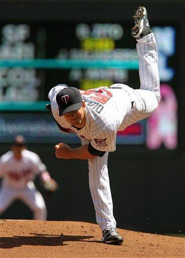 Minnesota Twins starting pitcher Scott Diamond throws against the Toronto Blue Jays during the first inning of a baseball game on Sunday, May 13, 2012, in Minneapolis. (AP Photo/Genevieve Ross)