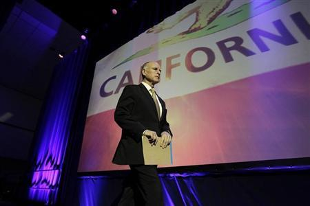 California Governor Brown walks onstage to speak at the 2014 California Democrats State Convention at the Los Angeles Convention Center in Los Angeles