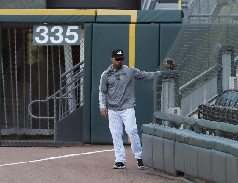 Chicago White Sox's Leury Garcia checks out the new protective netting that was extended to the right field foul pole before a baseball game between the White Sox and the Miami Marlins, Monday, July 22, 2019, in Chicago. (AP Photo/Charles Rex Arbogast)
