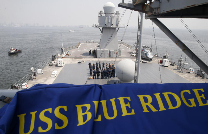 "U.S. Navy sailors gather on the deck of the USS Blue Ridge (LCC-19), the U.S. 7th Fleet Flagship, as it anchors off Manila Bay west of Manila, Philippines for a routine port call Wednesday, March 13, 2019. Capt. Eric Anduze, Commander of the USS Blue Ridge, renewed an American vow to ""sail, fly and operate wherever the law allows us to"" amid China's objection to U.S. military presence in the disputed South China Sea. (AP Photo/Bullit Marquez)"