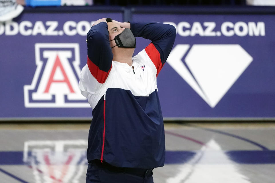 FILE - Arizona head coach Sean Miller reacts during the first half of an NCAA college basketball game against UCLA in Tucson, Ariz., in this Saturday, Jan. 9, 2021, file photo. Arizona has parted ways with men's basketball coach Sean Miller as the program awaits its fate in an NCAA infractions investigation, a person with knowledge of the situation told The Associated Press. The person told the AP on condition of anonymity Wednesday, April 7, 2021, because no official announcement has been made.(AP Photo/Rick Scuteri, FIle)