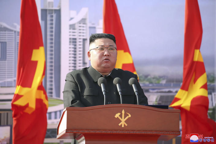 """In this photo provided by the North Korean government, North Korean leader Kim Jong Un speaks during a ceremony to break ground for building 10,000 homes, in Pyongyang, North Korea, Tuesday, March 23, 2021. The White House says North Korea fired short-range missiles this past weekend, just days after his sister Kim Yo Jong threatened the United States and South Korea for holding joint military exercises. Independent journalists were not given access to cover the event depicted in this image distributed by the North Korean government. The content of this image is as provided and cannot be independently verified. Korean language watermark on image as provided by source reads: """"KCNA"""" which is the abbreviation for Korean Central News Agency. (Korean Central News Agency/Korea News Service via AP)"""