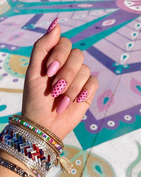 """<p>A flirty pink manicure with red or magenta polka dots references Valentine's Day but will still look cool a week after.</p><p><a href=""""https://www.instagram.com/p/Btd50vuFbqy/"""" rel=""""nofollow noopener"""" target=""""_blank"""" data-ylk=""""slk:See the original post on Instagram"""" class=""""link rapid-noclick-resp"""">See the original post on Instagram</a></p>"""