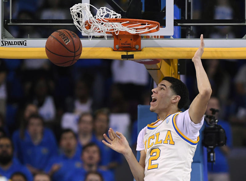 FILE - In this Saturday, March 4, 2017, file photo, UCLA guard Lonzo Ball dunks during the first half of an NCAA college basketball game against Washington State in Los Angeles. Ball is expected to be a top pick at the NBA Draft on Thursday, June 22. (AP Photo/Mark J. Terrill, File)