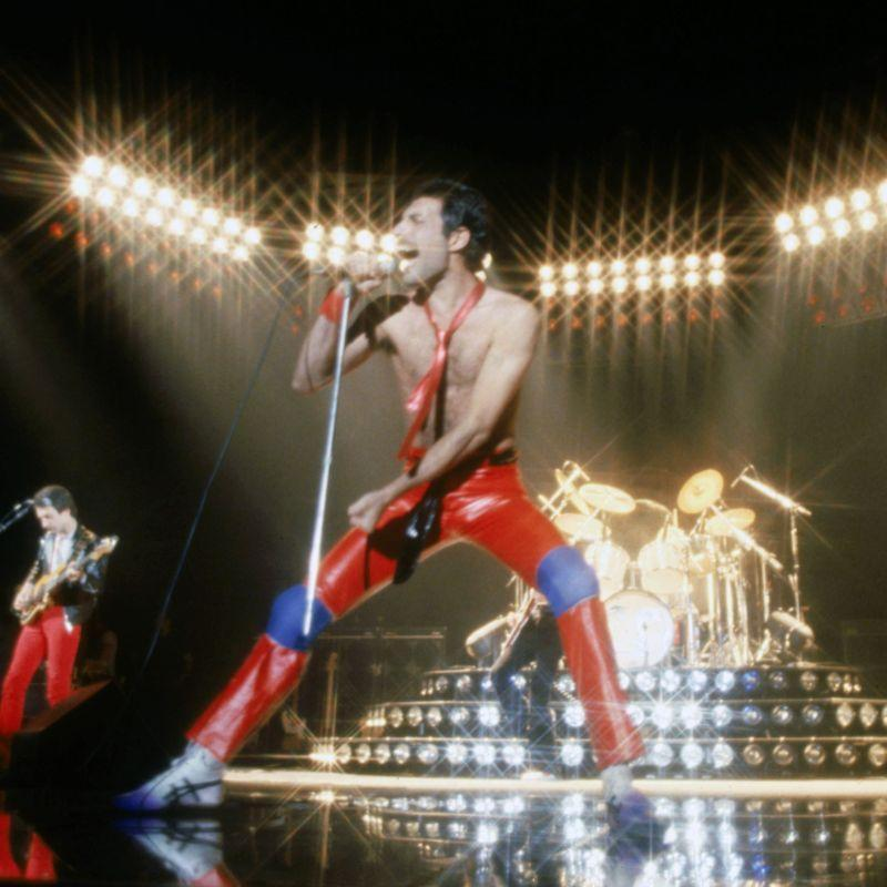"""<p>This mega-recognizable hit was written after a Queen concert in 1977. """"'We Will Rock You' was a response to a particular phase in Queen's career, when the audience was becoming a bigger part of the show than we were,"""" Brian May <a href=""""https://www.rollingstone.com/music/music-features/queens-news-of-the-world-10-things-you-didnt-know-195704/"""" rel=""""nofollow noopener"""" target=""""_blank"""" data-ylk=""""slk:explained in an interview"""" class=""""link rapid-noclick-resp"""">explained in an interview</a>. """"So, both Freddie and I thought it would be an interesting experiment to write a song with audience participation specifically in mind.""""</p>"""