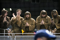 San Diego Padres fans dressed like friars cheer and hold their hands in prayer during the team's baseball game against the Miami Marlins, Friday, July 23, 2021, in Miami. (AP Photo/Lynne Sladky)